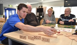 Everton player Bryan Oviedo chats and plays games with people who sufferer with dementia to help  with dementia awareness campaign